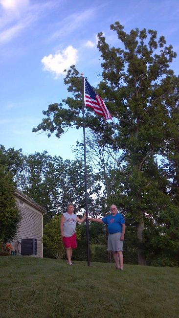 Resident installs (Board Approved, of Course) a flag pole on common ground next to his home on Crystal View